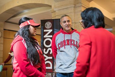 A student and parent talks with the Dean