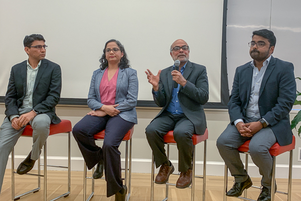 Authors speaking on a panel at the launch event
