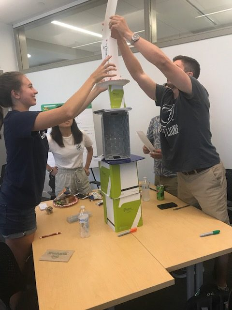 Students building a tower