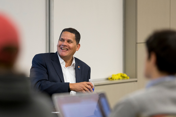Reggie sits at the front of a classroom
