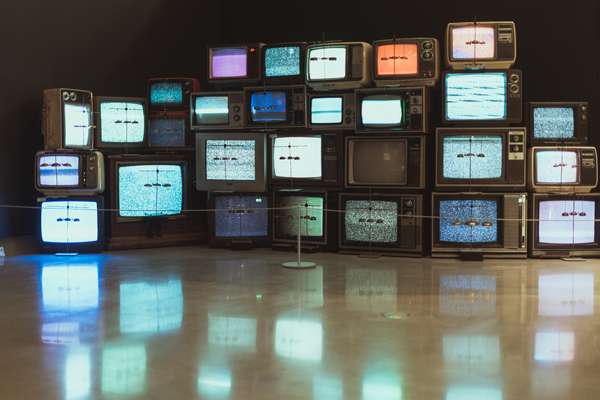 rows of televisions showing static