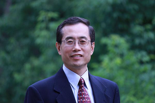 upper body photo of Jinhua Zhao